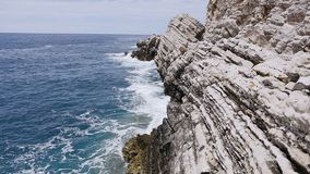 Beautiful sea waves spatter the rocks in summer day. Adriatic sea