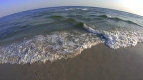 Beautiful sea waving near shore. Foamy sea waves on beach at resort. Magic sounds of the sea stock footage