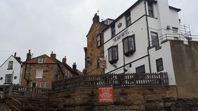 The Bay Hotel, Robin Hoods Bay. Beautiful seafront hotel and the picturesque Robin Hoods Bay in North Yorkshire, England stock image