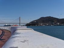 The beautiful seafront of Yeosu city and big arch bridge on the background stock photo