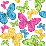 Beautiful seamless background with bright colorful butterflies. Hand-drawn contour lines and strokes. Perfect for background greeting cards and invitations to Stock Photography