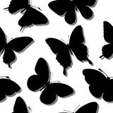 Beautiful seamless background with butterflies silhouettes. Royalty Free Stock Image