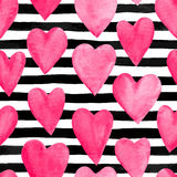 Beautiful seamless background with pink watercolor hearts on horizontal ink, black and white stripes. Royalty Free Stock Photography