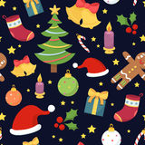 Beautiful seamless pattern with christmas symbols on dark blue b Royalty Free Stock Images