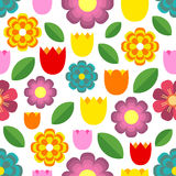 Beautiful seamless pattern of colorful flowers - tulips, chamomile, daisy and leaves. Stock Photos