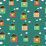 Beautiful seamless pattern with colorful houses and clouds Stock Images