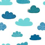 Beautiful seamless pattern of doodle clouds. design background greeting cards and invitations and for baby clothes. Stock Photos