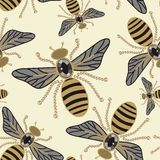 Beautiful seamless pattern of flying bees shiny gold and black print with precious rhinestones, embroidery and jewelry. Stock Photos