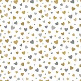 Beautiful seamless pattern with gold and silver glittering hearts on white background. design for holiday greeting card Royalty Free Stock Images