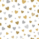 Beautiful seamless pattern with gold and silver glittering hearts on white background. Royalty Free Stock Images