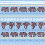 Beautiful seamless pattern Indian Elephant with ornamental strips. Hand drawn ethnic tribal decorated Elephant. Blue brown beige c. Ontour on Blue endless Royalty Free Stock Photo