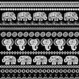 Beautiful seamless pattern Indian Elephant with ornamental strips. Hand drawn ethnic tribal decorated Elephant. White contour on B. Lack background. for site Stock Photo