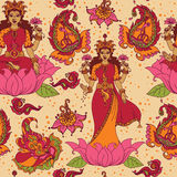 Beautiful seamless pattern with indian goddess Lakshmi and paisley ornament Royalty Free Stock Photos
