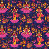 Beautiful seamless pattern with indian goddess Lakshmi and paisley ornament Stock Photos