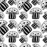 Beautiful Seamless pattern with monochrome vintage hand-drawn mushroom. Bright psychedelic mosaic amanita graphic illustration. Stock Image