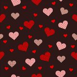 Beautiful seamless pattern with pink heart on red background stock image