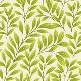Green leaves on beige background. Seamless pattern