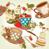 Beautiful seamless wallpaper pattern with cups of tea and strawb Stock Image
