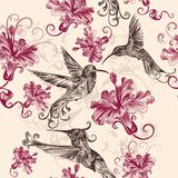 Beautiful seamless wallpaper pattern with hummingbirds and flowe Stock Photography