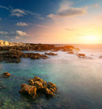 Beautiful seascape. Sea and rock at the sunset. Nature composition stock photo