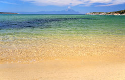 Beautiful seascape. Seascape with clear see-through turquoise water and mount Athos at the horizont Royalty Free Stock Photography