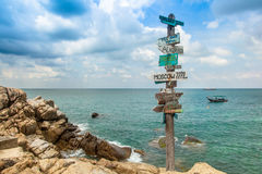 Beautiful seascape. Ancient pointer distances in different direc Stock Photos
