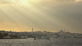Beautiful seascape with bank of old historical buildings of Istanbul Turkey with Suleymaniye mosque in a sunbeams at stock video footage