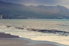 Beautiful seascape,  beach and mountains Stock Photos