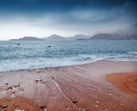 Beautiful seascape, beach and mountains Stock Photo