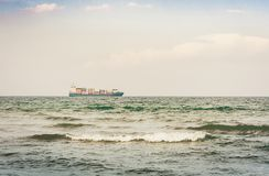 Beautiful seascape with cargo ship from coast of Catania, Sicily, Italy.  stock photos