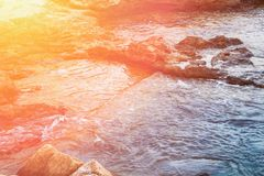 Beautiful Seascape Coastline Blue Water Waves Golden Pink Sun Flare Romantic Mysterious Idyllic Atmosphere Tranquility. Copy Space Inspirational Stock Photos