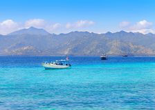 Beautiful seascape with island. Amazing landscape of turquoise sea water with boats sailing on background of island Gili Trawangan Stock Photography