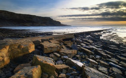 Beautiful seascape landscape of rocky shore at sunset Royalty Free Stock Photo