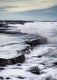 Beautiful seascape landscape of rocky shore at sunset Stock Photography