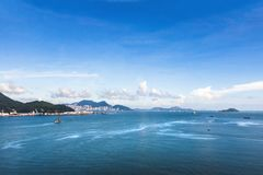 Beautiful seascape and modern building with hill at Hong Kong. royalty free stock images