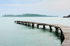 Beautiful seascape in morning time with wood bridge into sea Royalty Free Stock Photo