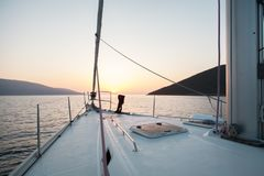 Sea, mountains, sun. Journey. Nose sailing yacht. stock image