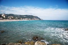 Pebble beach and blue sky on background royalty free stock images