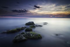 Beautiful seascape of a rock formation taken with a long exposure royalty free stock images