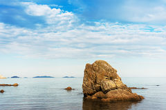 Beautiful seascape with rocks and cloudy sky. Royalty Free Stock Photography