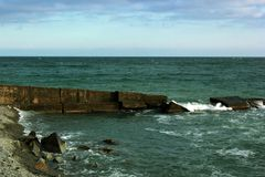 Beautiful seascape, rocks and sea, blue, turquoise water and sky royalty free stock image