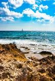 Beautiful seascape with sailboat. Idyllic seascape with sail boat at the horizon on a beautiful summer day Stock Photo
