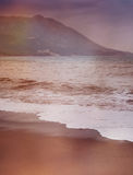 Beautiful seascape, sandy beach and mountains Royalty Free Stock Images