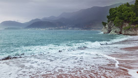 Beautiful seascape, sandy beach and mountains Stock Photography
