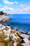 Beautiful seascape - sea, blue sky and coast rocks Royalty Free Stock Photos