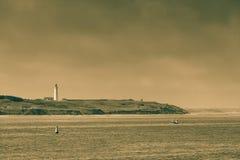 Coastline with lighthouse Hirtshals Denmark. Beautiful seascape sea horizon and coastline with lighthouse Hirtshals, Denmark, Europe Stock Images