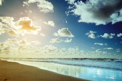 Beautiful seascape with sea waves, blue sky, white cumulus clouds and sand beach. Summer vacation tropical landscape. Baltic sea, Pomerania, northern Poland Stock Photo