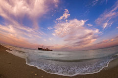 Beautiful seascape with a ship wreck on the shore of Black Sea Stock Photo