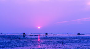 Beautiful seascape when the sunset. Cottage located in the sea. The accommodation of the fishermen. Beautiful seascape when the sunset Stock Photo