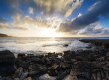 Beautiful seascape at sunset with dramatic clouds landscape imag Stock Images